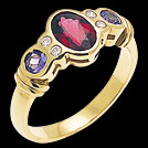 C882 Oval Garnet and Round Tanzanite Diamond Yellow Gold Ring