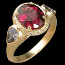C1709 Oval Rhodolite and Pear Tanzanite and Diamond Yellow Gold